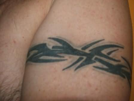 Amazing Arm Band Tattoo On Muscle