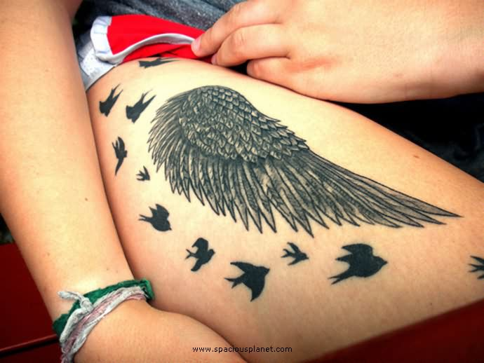 birds bird wing tattoo on thigh