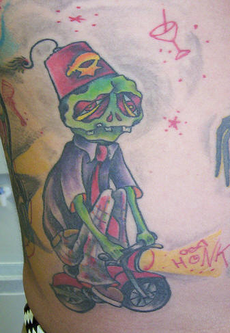 Funny Skeleton On Cycle Tattoo