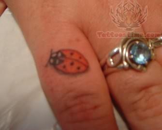 Ladybug Tattoo On Finger
