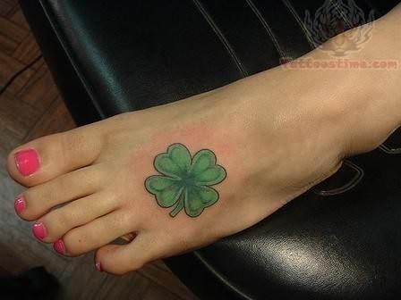 Elegant irish tattoo on foot for Shamrock foot tattoo