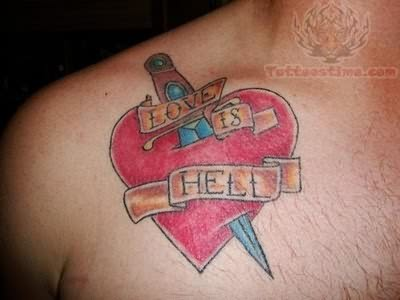 Heart Dagger Tattoo On Chest