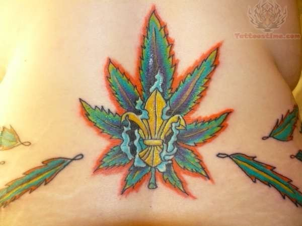 Pot leaf tattoo on back for Tattoo of weed leaf