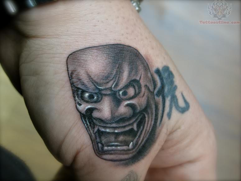 Mask Tattoo On Hand