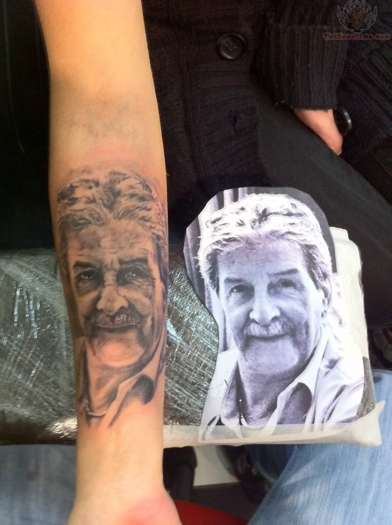 memorial portrait tattoo on arm