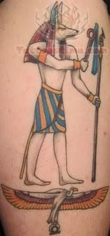 Elegant Egyptian Religious Tattoo
