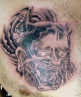 Monster Head Tattoo On Chest