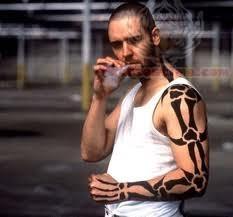 Movie Tattoo Design On Biceps