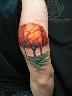 Fire Tree Tattoo On Muscle