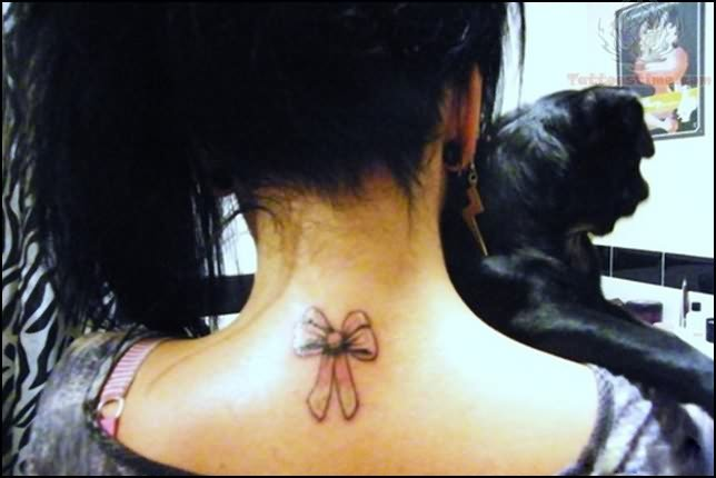 Bow Tattoo On Back Neck
