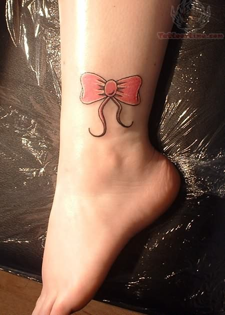 Pink Bow Tattoo on Her Ankle