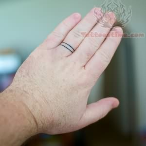 Wedding ring tattoo on finger for Wedding tattoos on fingers