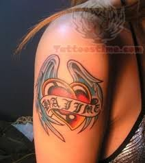 Winged Sacred Heart Tattoo On Bicep
