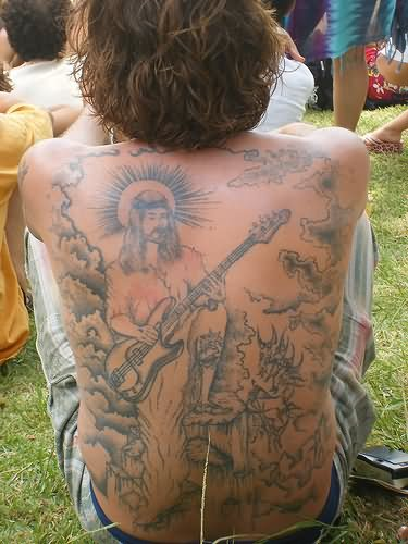 Jesus playing guitar tattoo on back for Jesus back tattoos