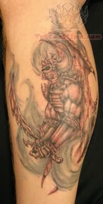 Warrior Tattoo On Back Leg