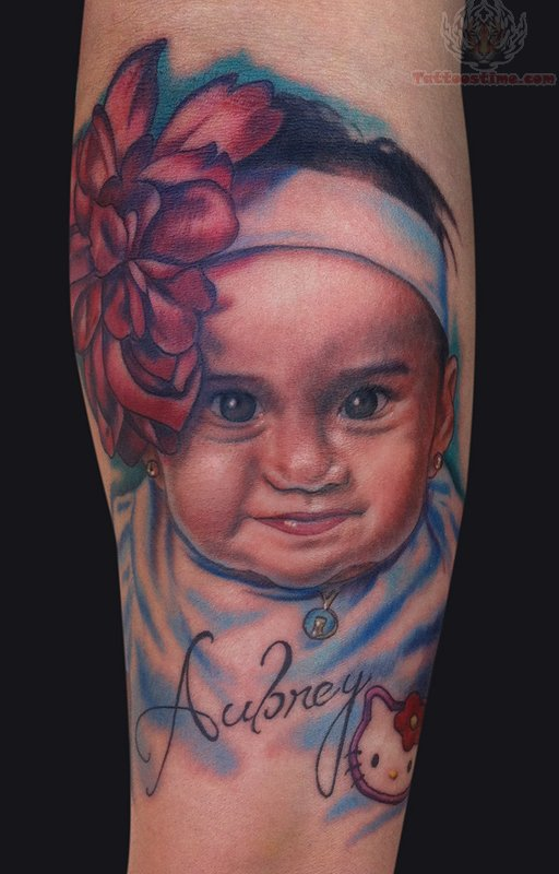 baby portrait tattoo on arm