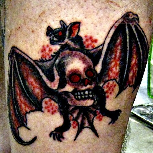 Skull And Bat Tattoo