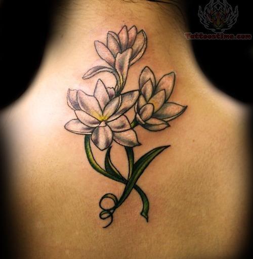 Flower feminine tattoo on back for Back tattoo flower designs
