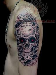 Red Eyes Skull Tattoo On Biceps