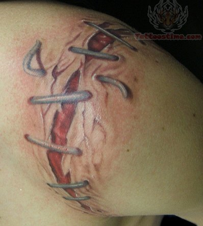 Torn Ripped Skin Tattoo On Shoulder