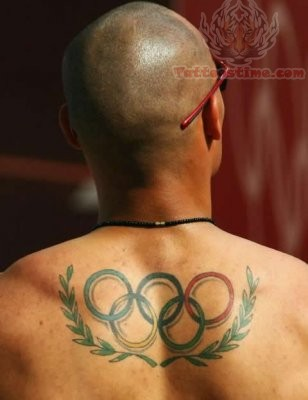 Andres Bayron Silva Showing Olympic Tattoo