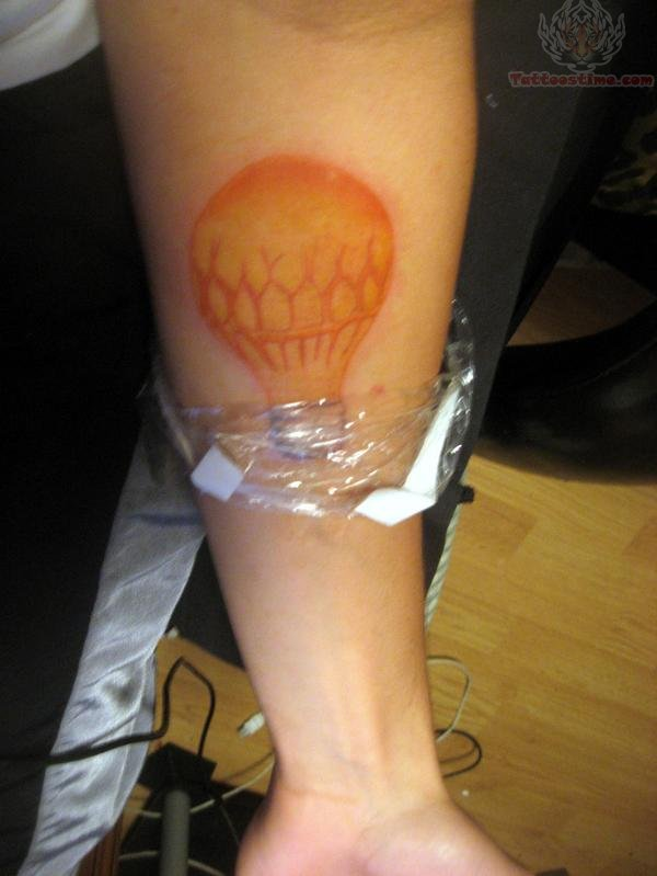 Yellow Ink Bulb Tattoo On Arm