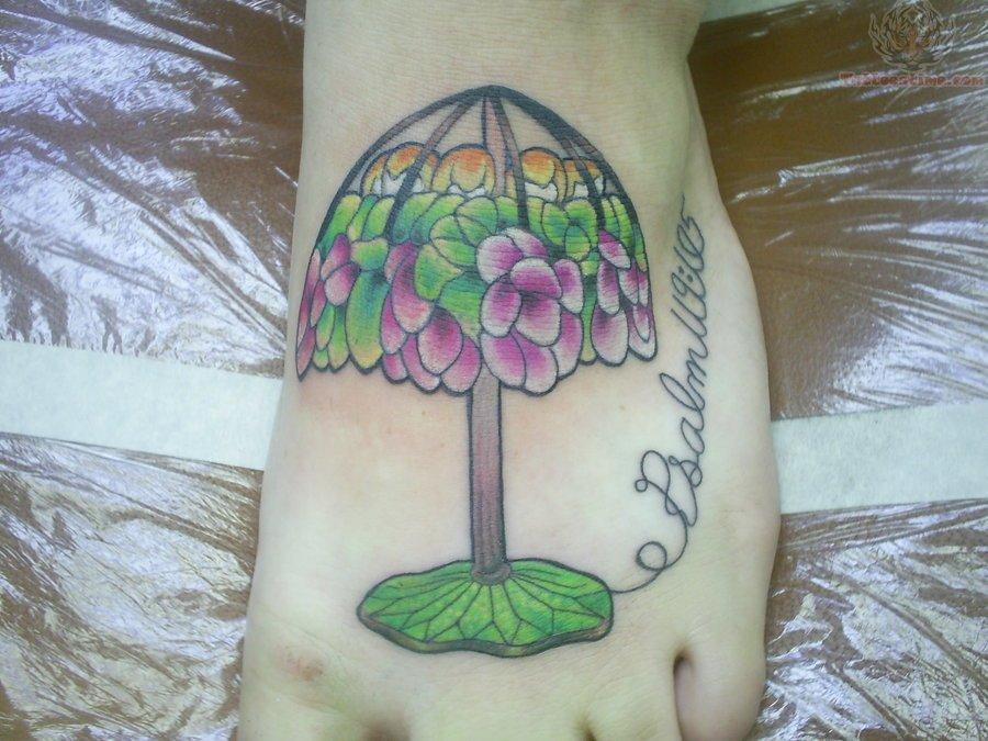 Beautiful Lamp Tattoo On foot