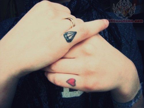 http://www.tattoostime.com/images/227/tumblr-diamond-tattoo-on-index-finger.jpg