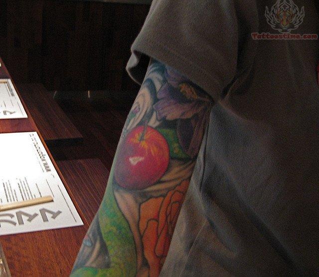 apple fruit tattoo on arm. Black Bedroom Furniture Sets. Home Design Ideas