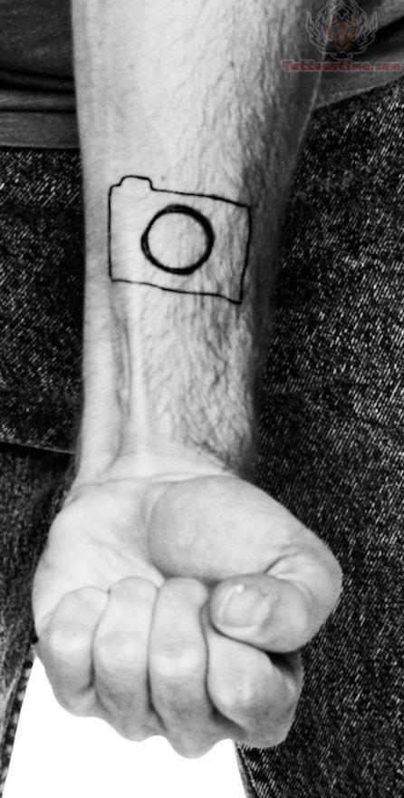 94f3d6b98 Unique Black Ink Camera Tattoo On Wrist