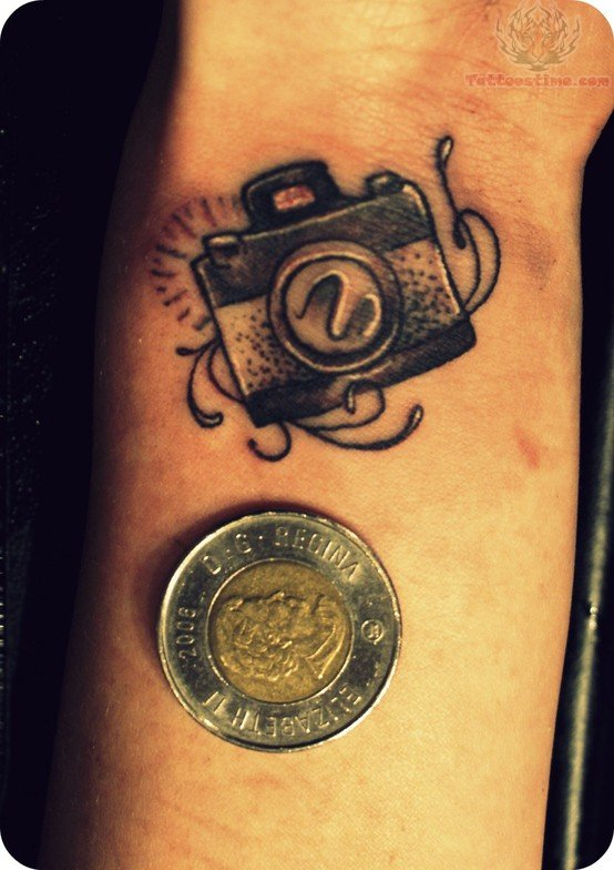 camera tattoo on wrist and coin. Black Bedroom Furniture Sets. Home Design Ideas
