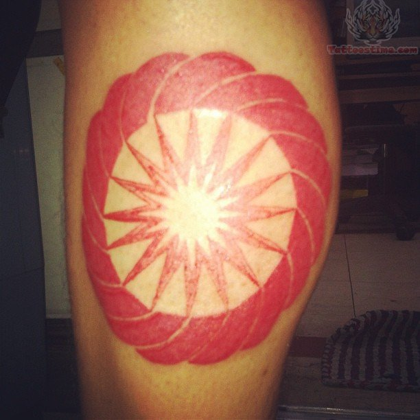 Red ink circle tattoo on calf for Red ink tattoos