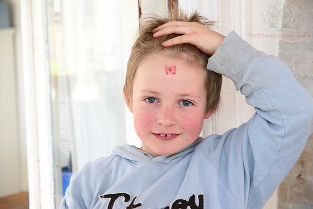 Bulb Tattoo On Child Forehead