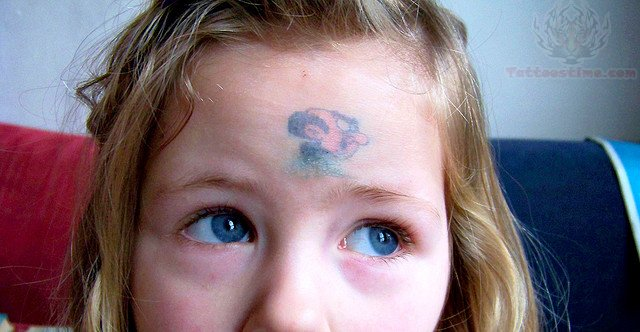 Cartoon Head Tattoo On Forehead