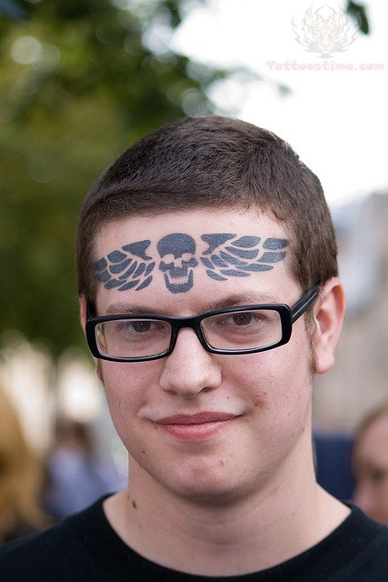Winged Skull Forehead Tattoo