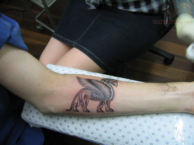 Brown ink griffin tattoo for Brown tattoo ink