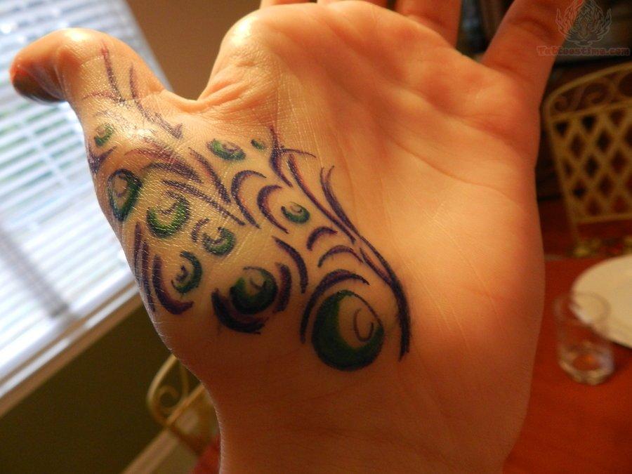 Mehndi Peacock Tattoos : Peacock tattoo on thumb