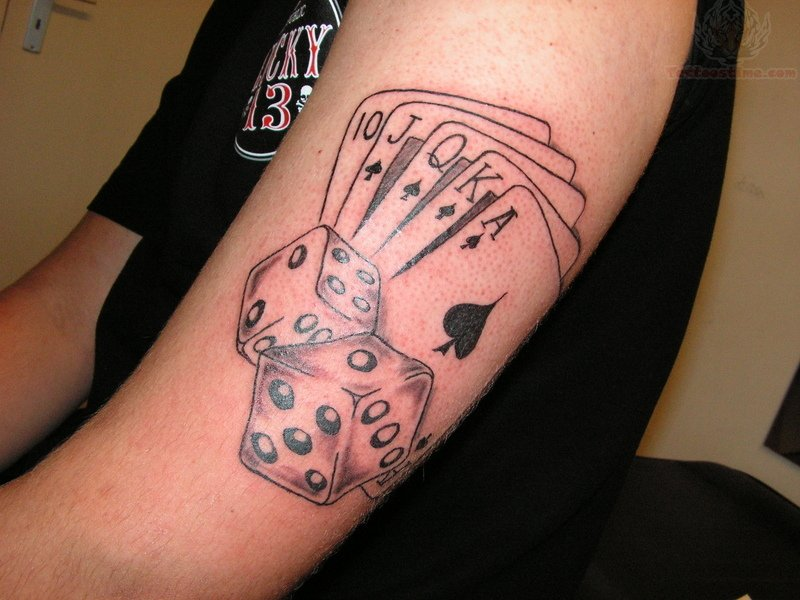 Poker Cards And Dice Tattoo On Bicep