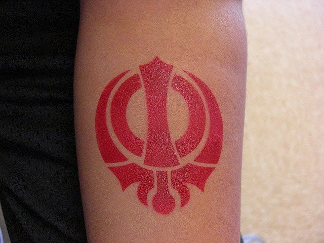 Red ink khanda tattoo for Red ink tattoos