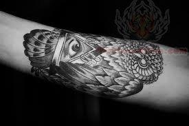Owl Eye Tattoo On Arm