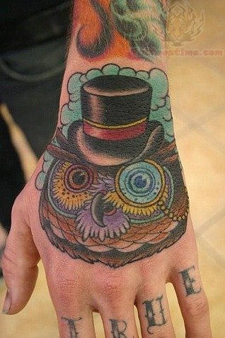 Owl Head With Hat Tattoo On Hand Angry Panther