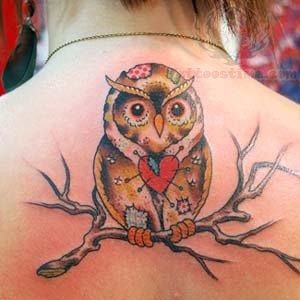 Owl pierced heart tattoo on upperback for Owl heart tattoo