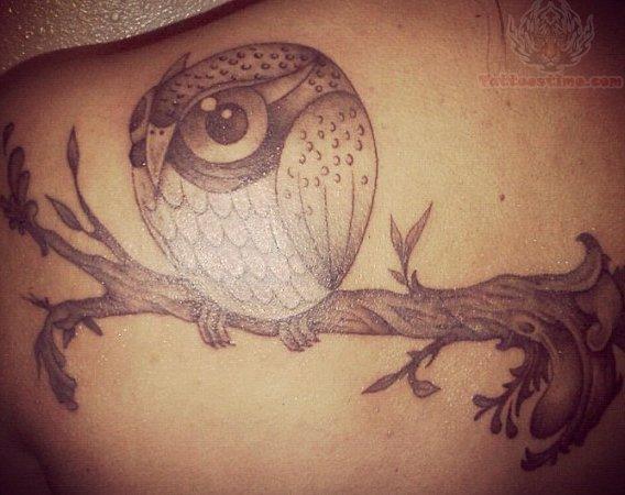 Owl On Tree Branch Tattoo