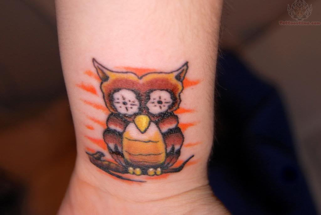 Tiny Owl Sitting On Branch Tattoo