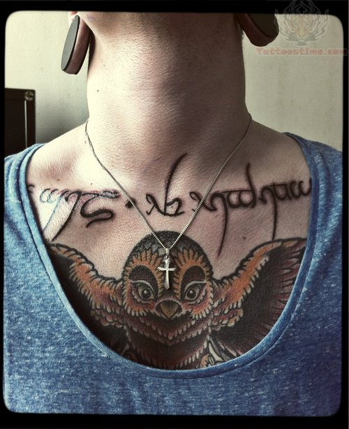 Words And Owl Tattoo On Chest