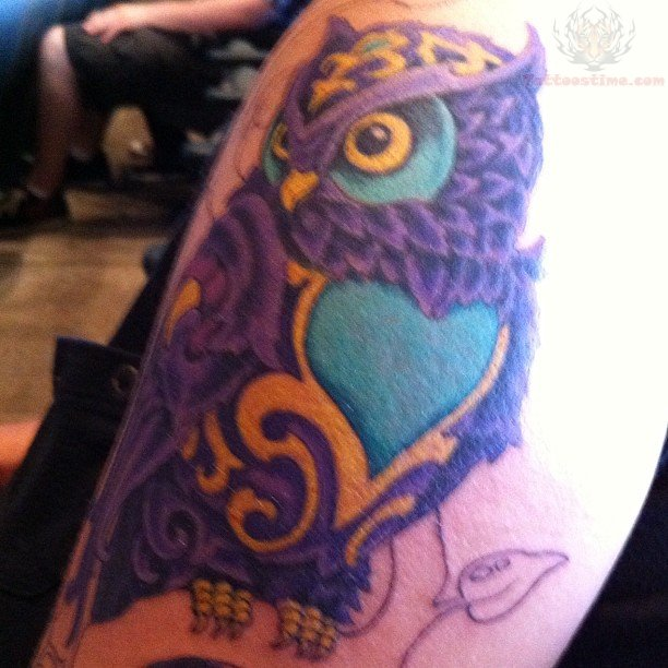 Red heart and owl tattoo on arm for Owl heart tattoo