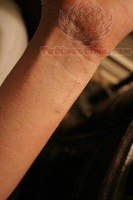 b3bc011ae White Ink Arrow Tattoo On Wrist
