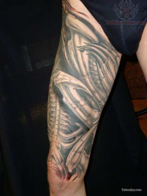 Mechanical tattoo images designs for Male thigh tattoos