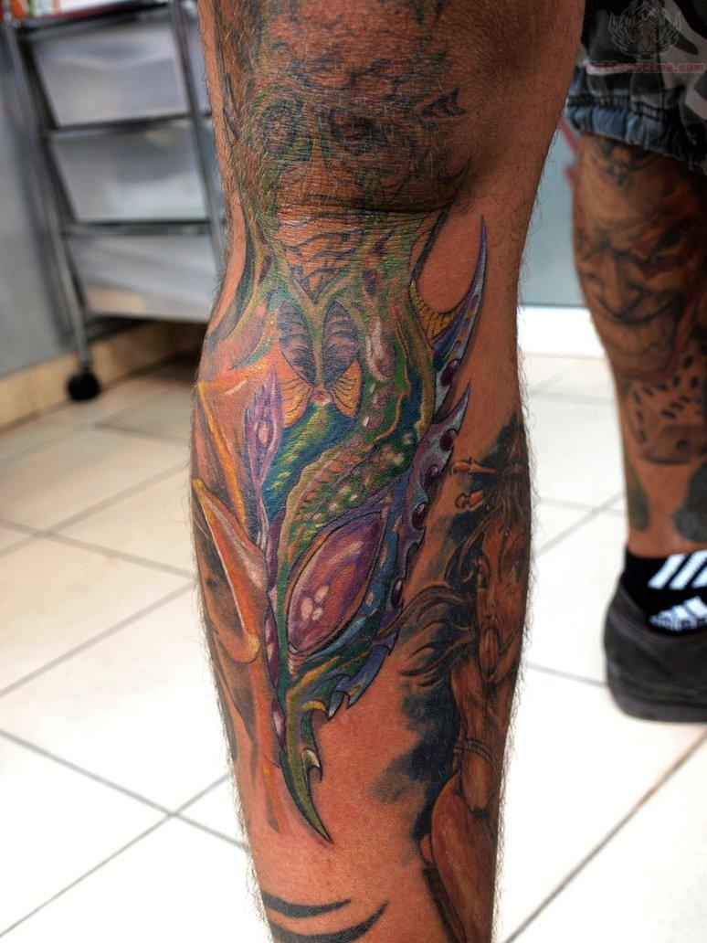 Color Bio Mechanical Tattoo On Men Leg