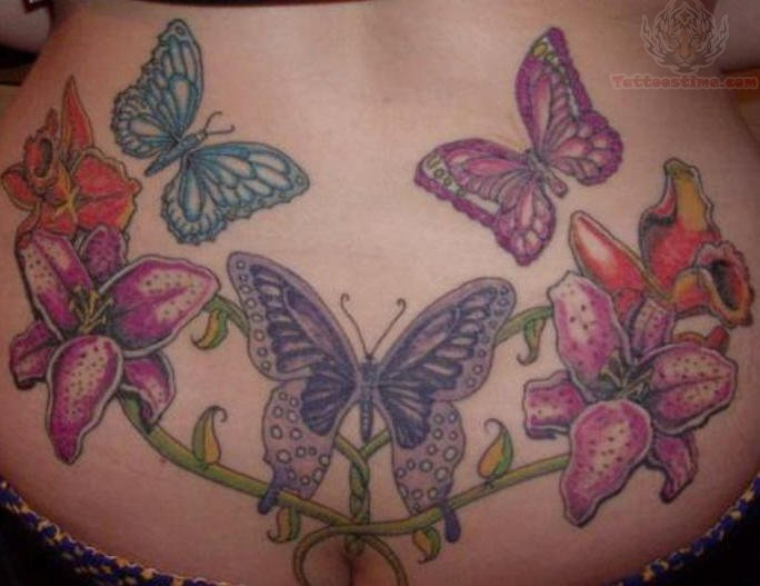butterflies and flowers lower back tattoo design. Black Bedroom Furniture Sets. Home Design Ideas
